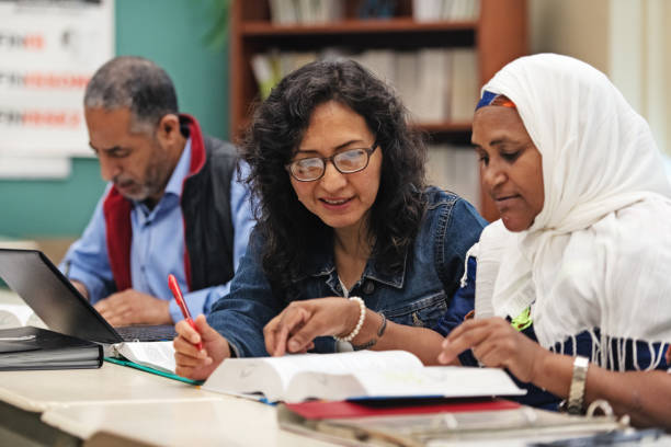 Multi-ethnic adults education classroom stock photo
