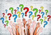 istock Multi-Ethnic Arms Outstretched To Ask Questions 487690127