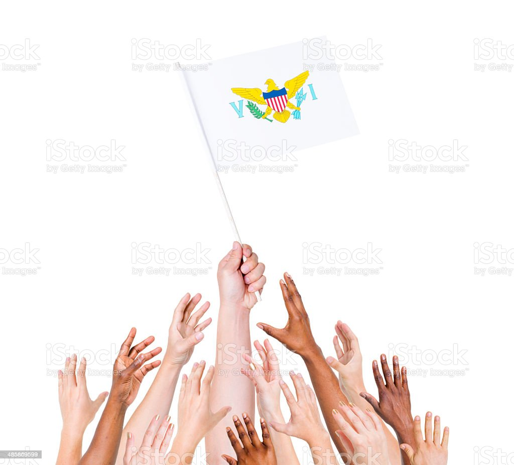 Multi-Ethnic Arms Raised for the Flag of Virgin Islands stock photo