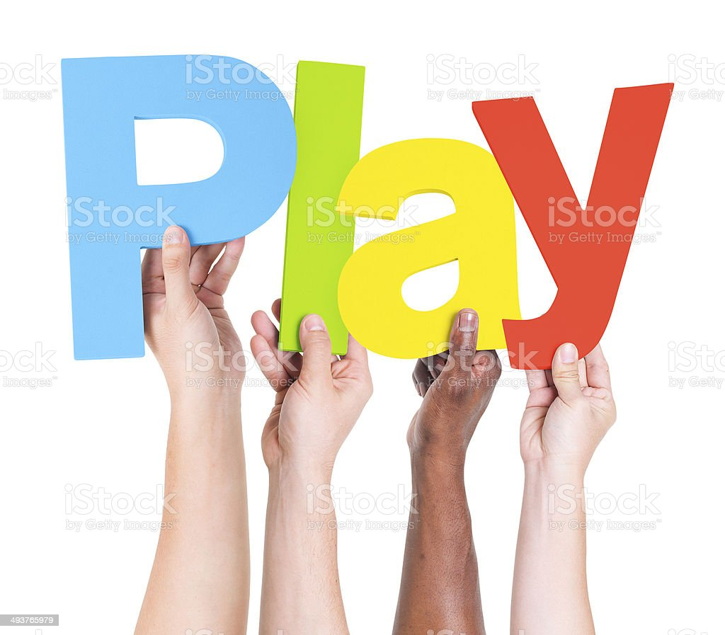 Multiethnic Arms Raised Holding Text Play stock photo