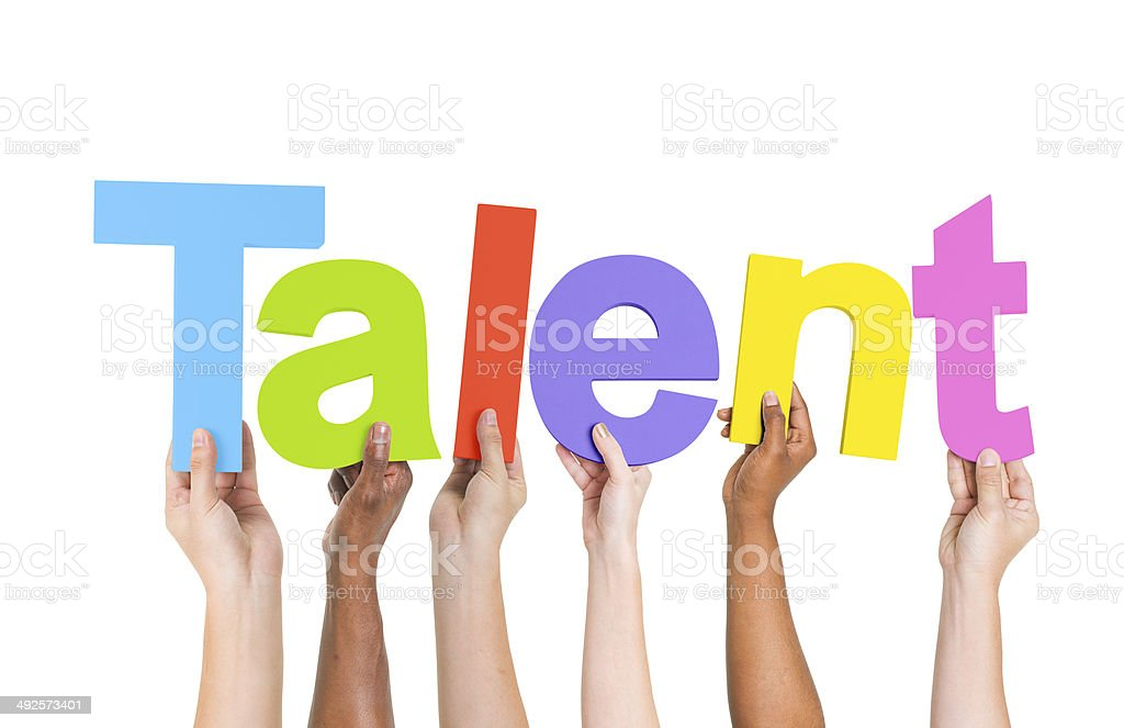 Multiethnic Arms Raised Holding Text Talent stock photo