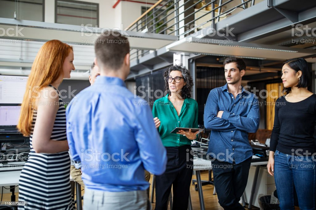 Multi-ethnic business colleagues having brainstorming session - Royalty-free Adult Stock Photo
