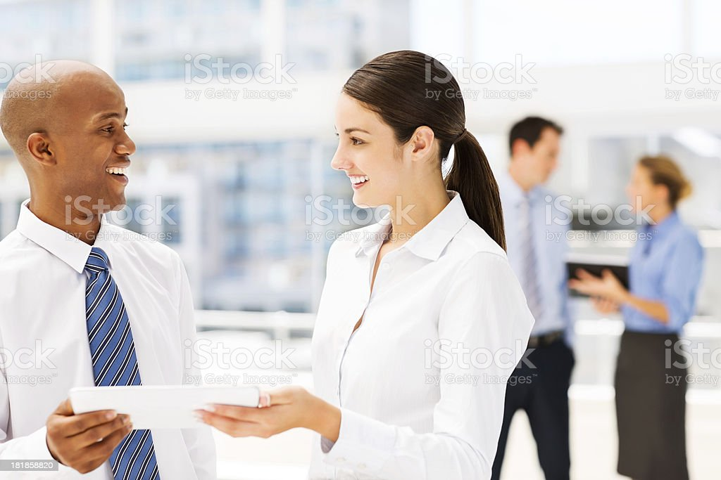 Multi-ethnic Business Colleagues Holding Digital Tablet royalty-free stock photo