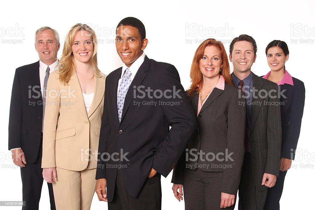 Multi-ethnic business group headed by attractive man royalty-free stock photo