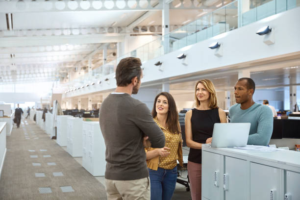 Multi-ethnic business people discussing at cubicle stock photo