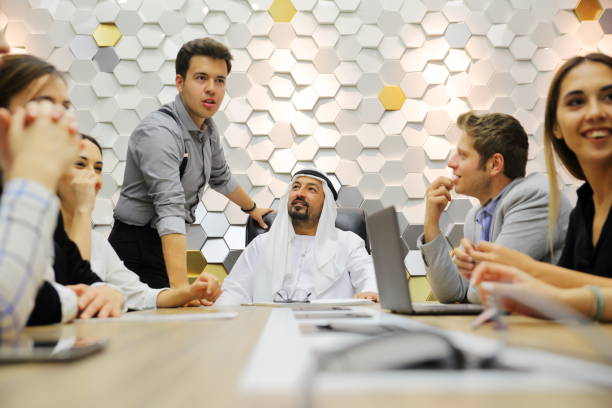 Multi-ethnic business people discussing in office stock photo