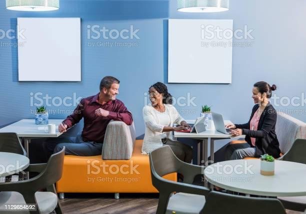 Multiethnic business people in coworking office space picture id1129654592?b=1&k=6&m=1129654592&s=612x612&h=hxeova azjoy16etmlswlh4alzoydzztkejdtmpkofs=
