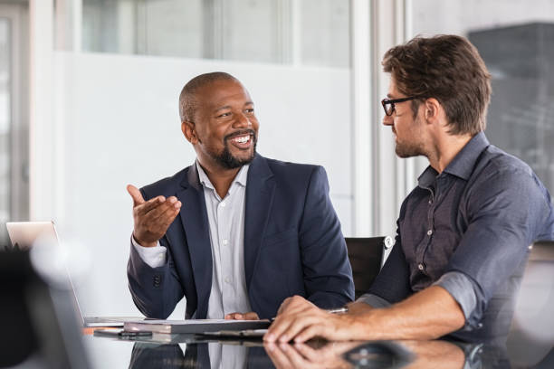 Multiethnic business people in meeting stock photo
