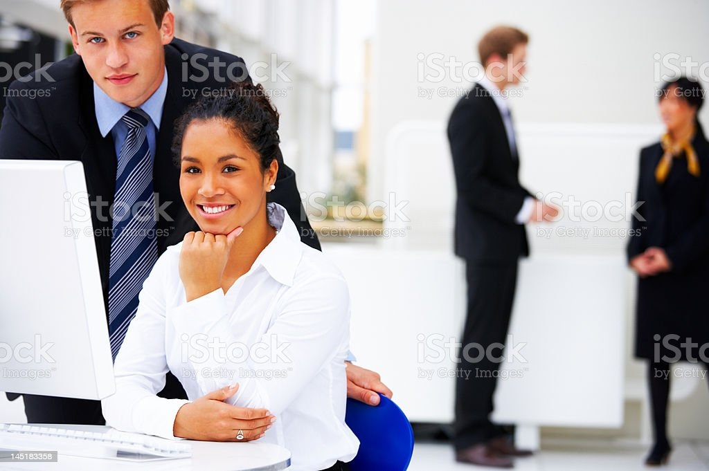 Multi-ethnic business people smiling royalty-free stock photo