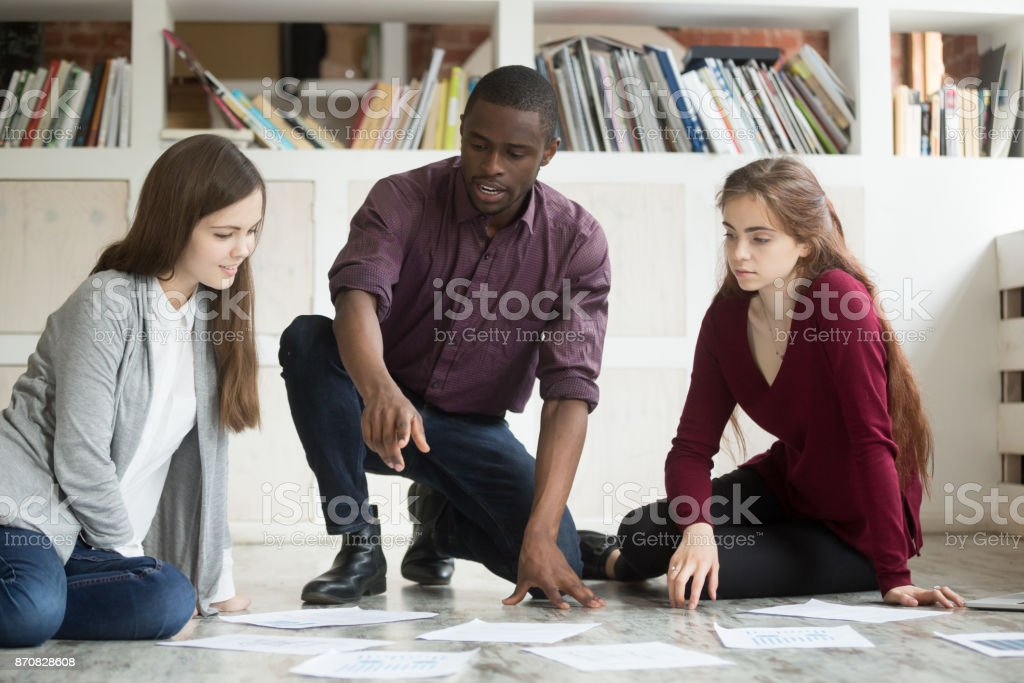 Multiethnic business team collaborating on project together. stock photo