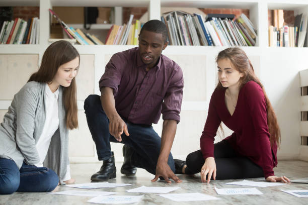 multiethnic business team collaborating on project together. - project manager stock photos and pictures