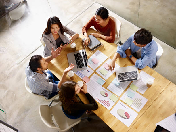 multiethnic business team meeting in office stock photo