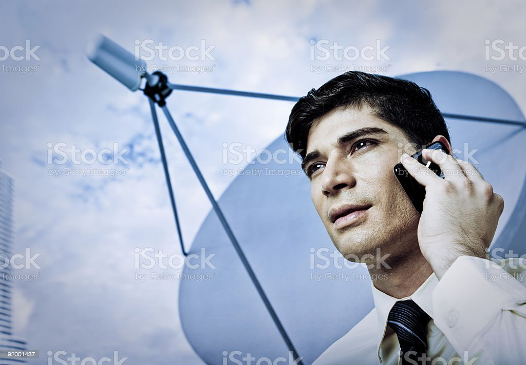 Multi-Ethnic Businessman on Mobile Phone with Satellite Dish stock photo