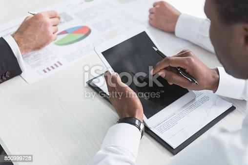 istock multiethnic businessmen during meeting 850999728
