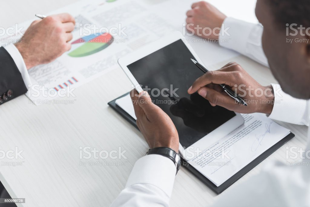 multiethnic businessmen during meeting stock photo