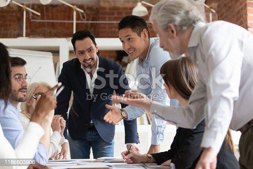 istock Multi-ethnic businesspeople brainstorming in office room 1186603906