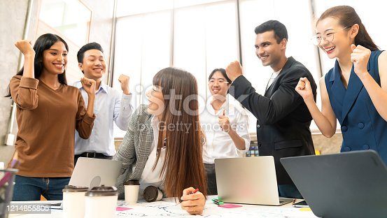 932724052 istock photo Multi-ethnic businesspeople cheering with business project successful in meeting room office backgroound 1214655805