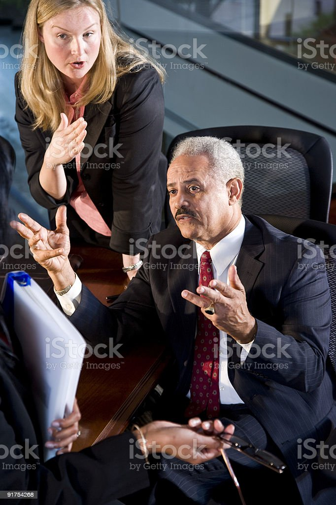 Multi-ethnic businesspeople in boardroom royalty-free stock photo