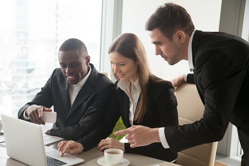 istock Multi-ethnic businesspeople working on laptop 843533936