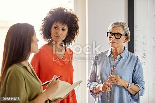 istock Multi-ethnic businesswomen discussing in office 916844626