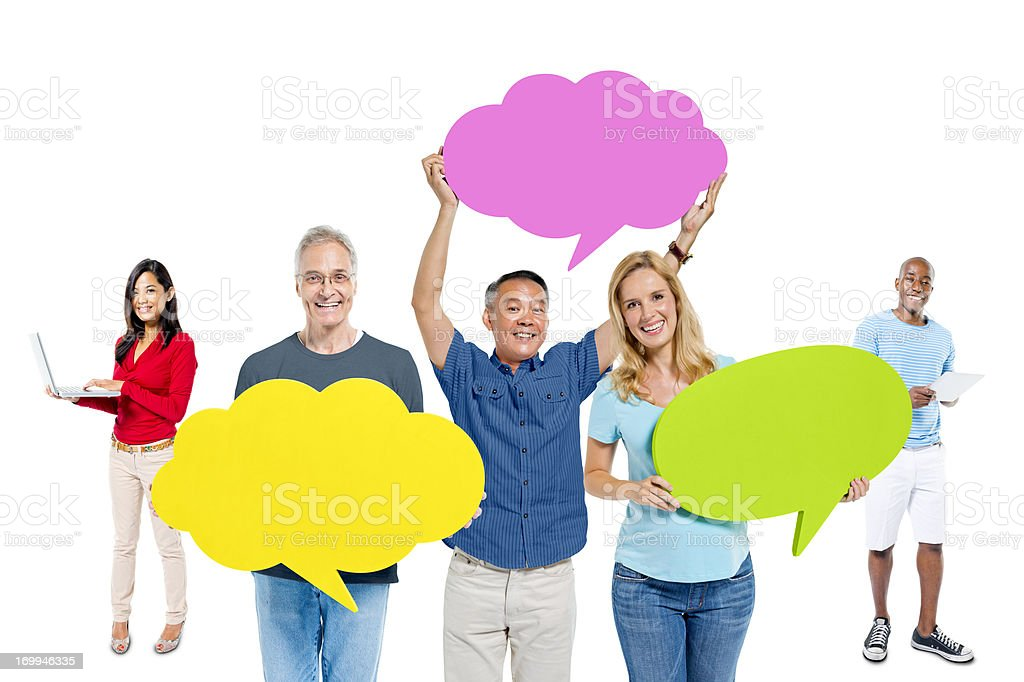 Multi-ethnic casual people holding the speech bubble royalty-free stock photo