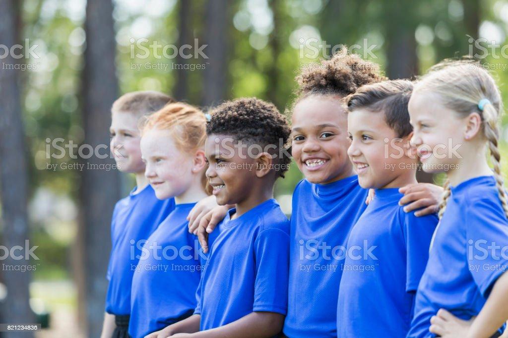 Multi-ethnic children at soccer camp stock photo