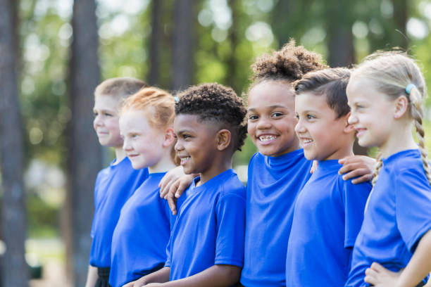 Multi-ethnic children at soccer camp stock photo