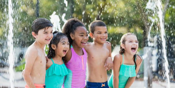 multi-ethnic children at water park - children play water park stock photos and pictures