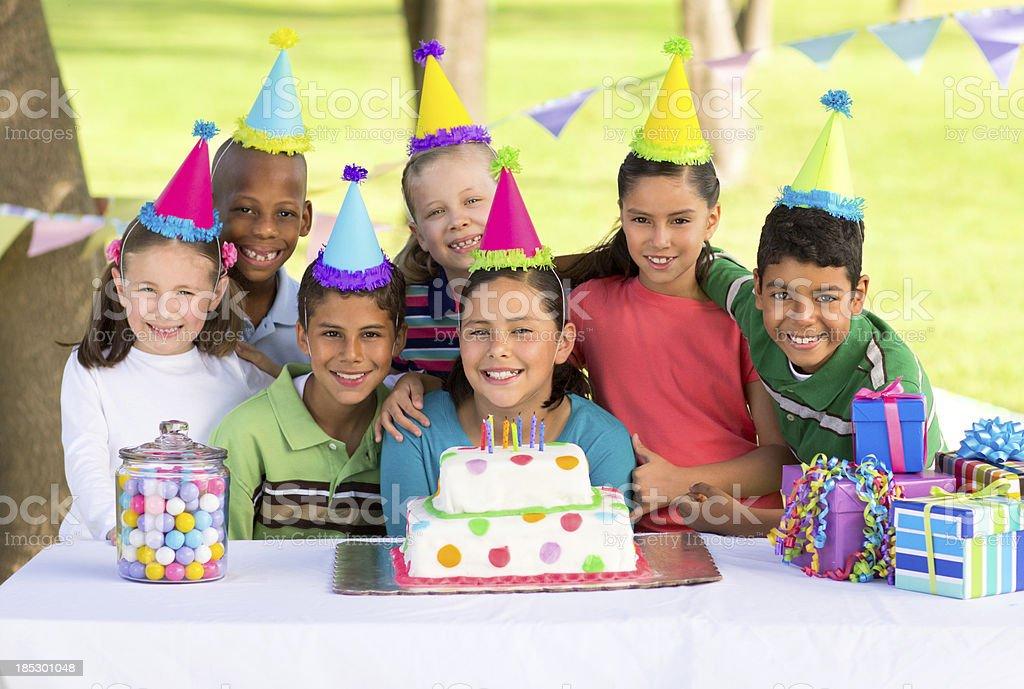 Multi-ethnic children celebrating a birthday royalty-free stock photo