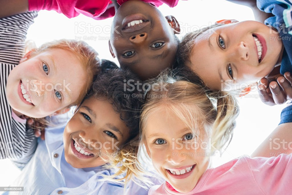 Multiethnic children in a circle royalty-free stock photo