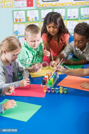 istock Multi-ethnic children in kindergarten doing art project 484487948
