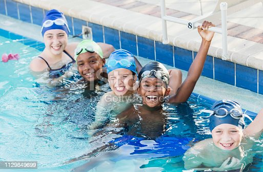istock Multi-ethnic children on swim team in pool 1129649699