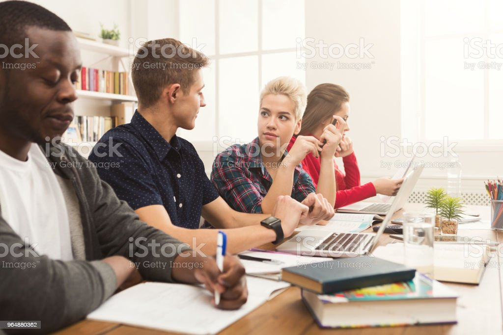Multiethnic classmates preparing for exams together royalty-free stock photo