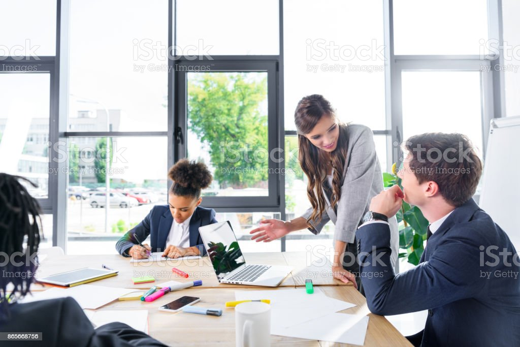 multiethnic colleagues at business meeting stock photo