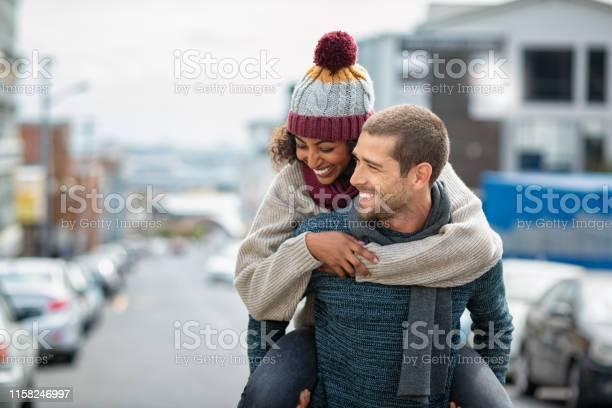 Multiethnic couple having fun in winter picture id1158246997?b=1&k=6&m=1158246997&s=612x612&h=wxuhrpxigncgftndq1xo0kz1mb1ewf5idptojorcbqc=