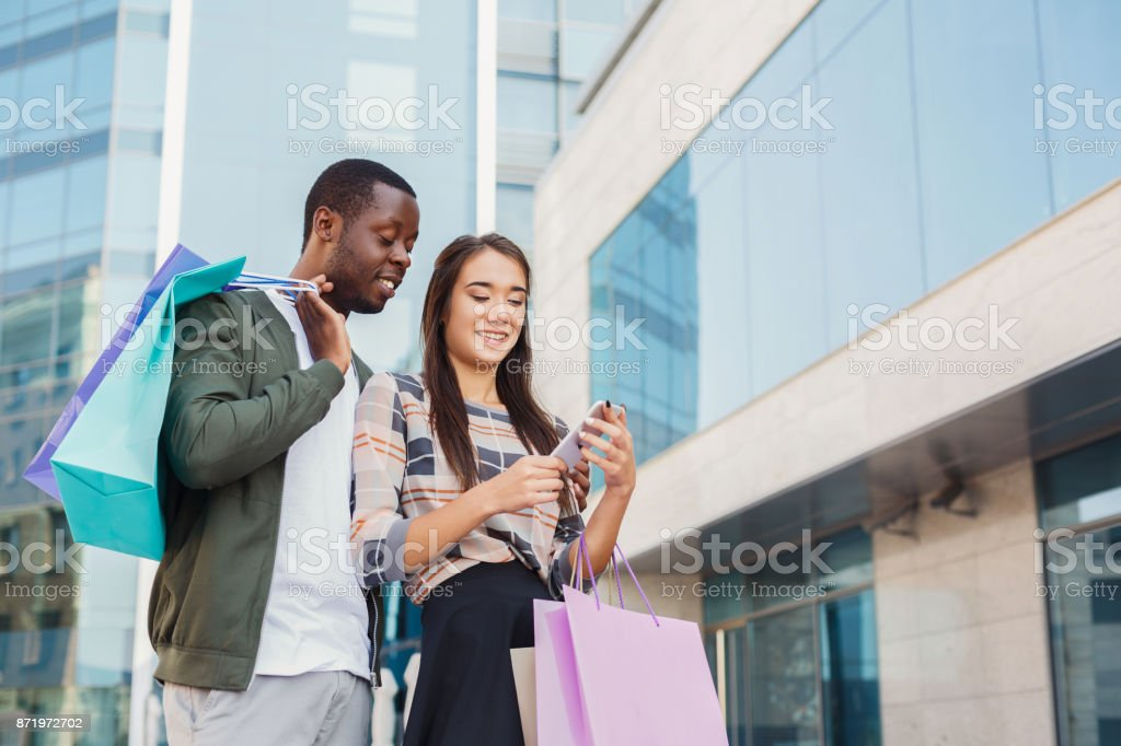 Multiethnic couple shopping together stock photo