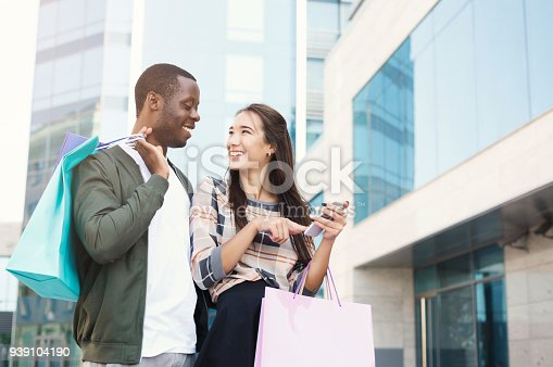 istock Multiethnic couple shopping together 939104190
