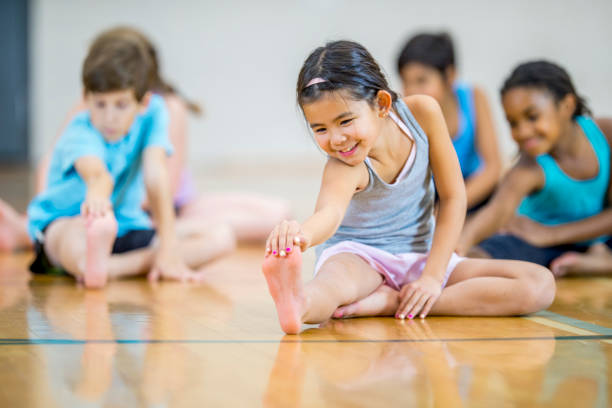 Multi-ethnic elementary age group stretching stock photo