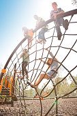 istock Multi-ethnic elementary school children playing on playground at park. 653141628