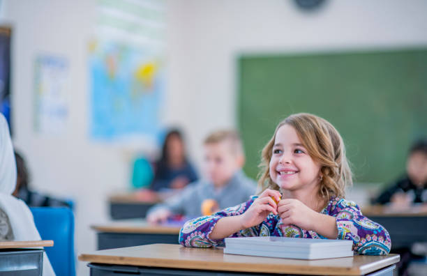 Multi-Ethnic Elementary Students in Class stock photo stock photo