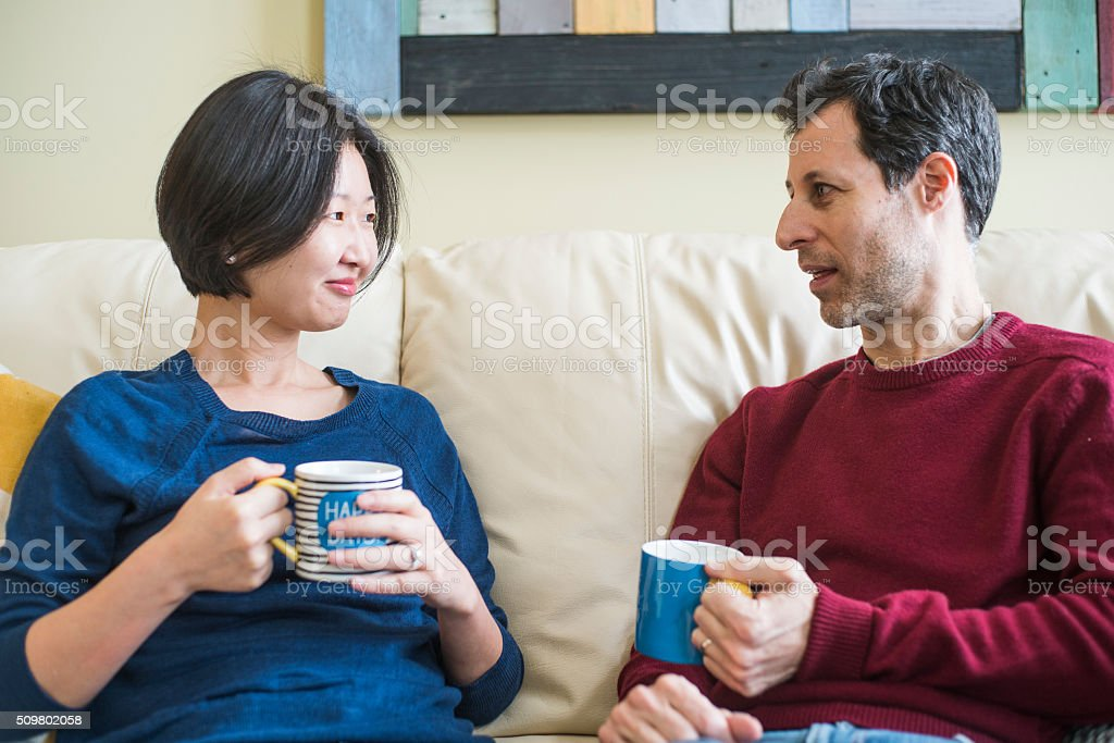 Multi-Ethnic family, caucaian man and korean woman, at home stock photo