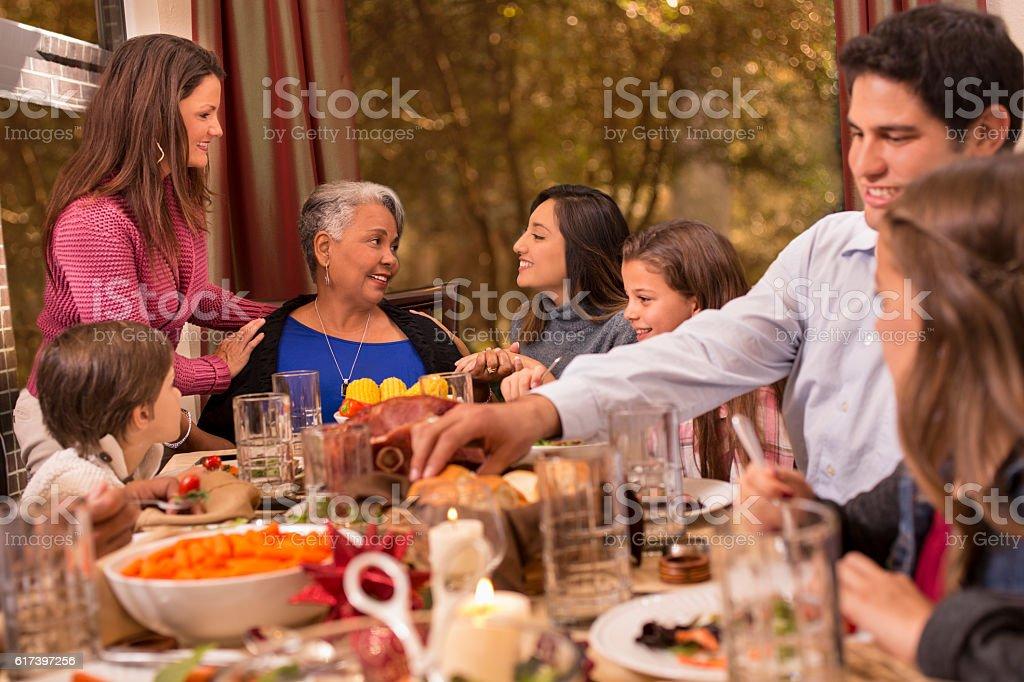 Foto De Multiethnic Family Enjoying Christmas Dinner At Grandmothers Home E Mais Fotos De Stock De 60 Anos Istock