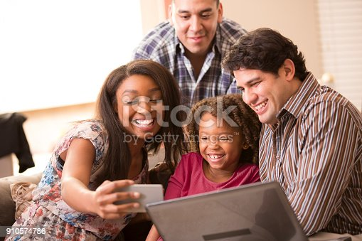 istock Multi-ethnic family having fun at home. 910574786