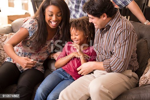 istock Multi-ethnic family having fun at home. 910574862