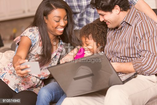 istock Multi-ethnic family having fun at home. 910574940