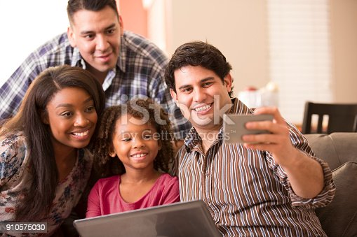 istock Multi-ethnic family having fun at home. 910575030