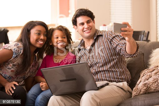 istock Multi-ethnic family having fun at home. 910575130