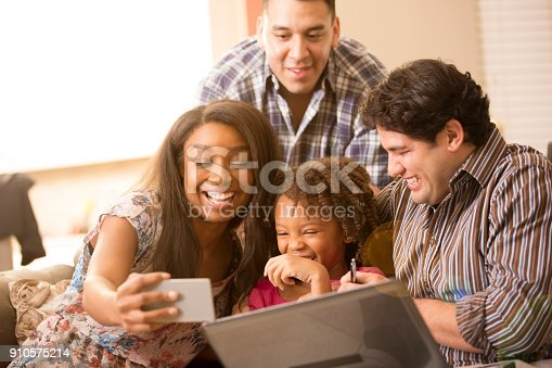 istock Multi-ethnic family having fun at home. 910575214