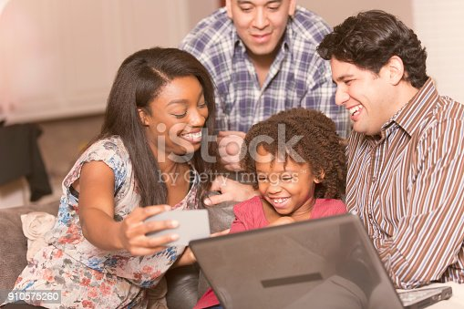 istock Multi-ethnic family having fun at home. 910575260