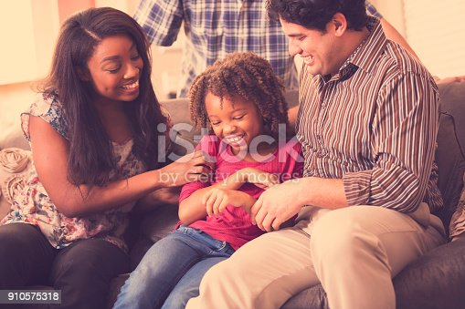 istock Multi-ethnic family having fun at home. 910575318